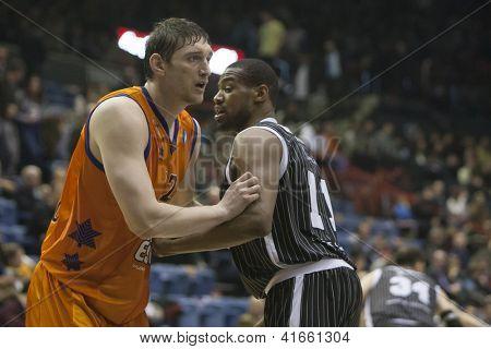 VALENCIA - JANUARY 29: #12 Serhiy Lischchuk and Lamont Hamilton during Bakestball match between Valencia Basket Club and Uxue Bilbao, on January 29, 2013, in La Fonteta Stadium, Valencia, Spain
