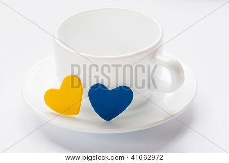 Empty Cup And Saucer With Hearts
