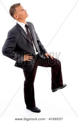 Side Pose Of Businessman Looking Upward