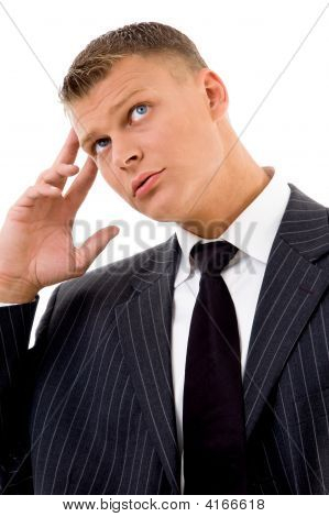 Young Employee In Tension Looking Upward