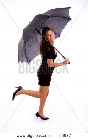 Side View Of Sexy Woman Carrying Umbrella