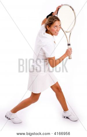 Side View Of Young Woman Playing Tennis