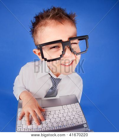 Five years old boy with a laptop computer