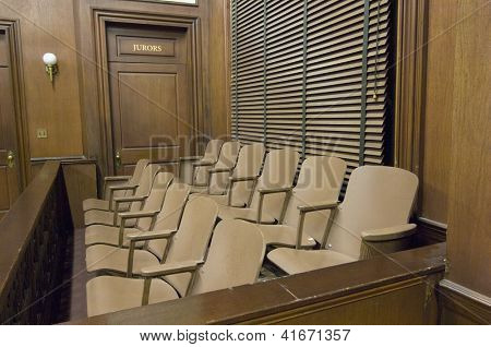 Side view of a empty jury box in the courthouse
