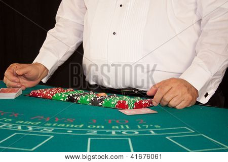 Casino Dealer and Chips