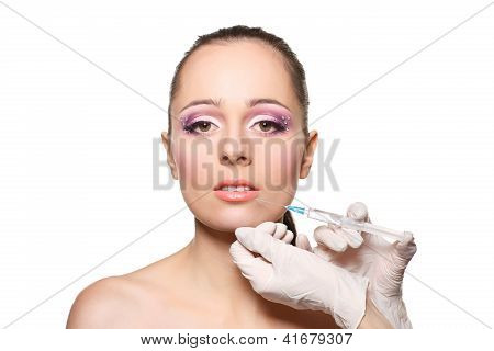 Cosmetic Injection To Female Face.