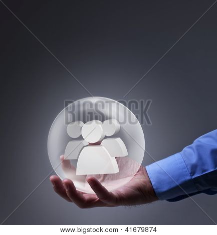 Male Hand Holding Glass Sphere With Social Networking Symbol