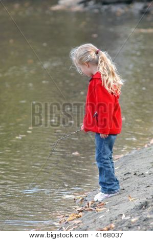 Girl On Riverbank