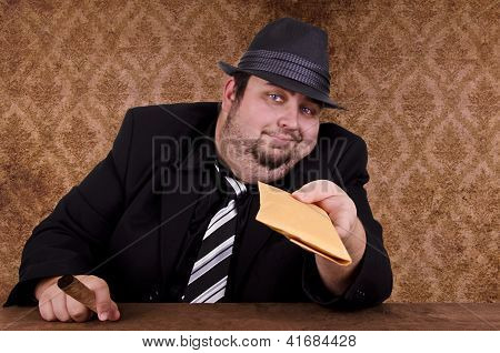 Gangster holding brown envelope