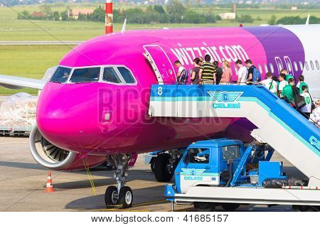 Budapest, Hungary - May 12: Passangers Boarding Wizzair Airplane. After The Bankruptcy Of Malev In H