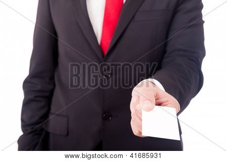 Business man giving a blank business card over white background
