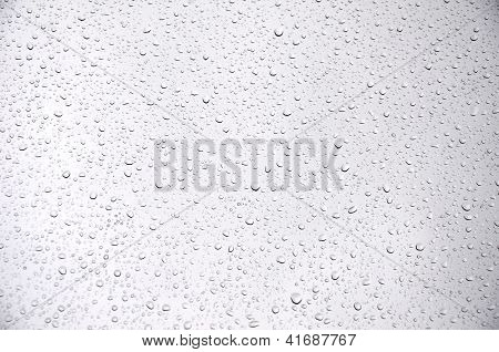 Waterdrops on the greyish background