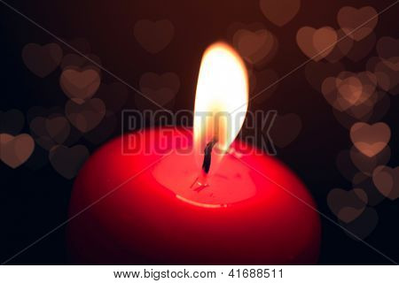 valentine candle with bokeh hearts