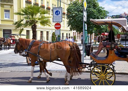 KARLOVY VARY CSZECH REPUBLIC - JULY 19: Horse carriage on a street in Karlovy Vary