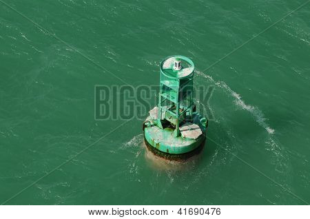 Green Buoy In Ocean