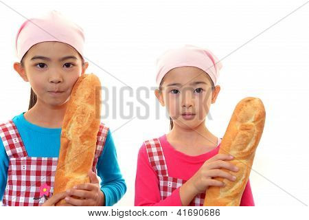 Smiling girls with bread