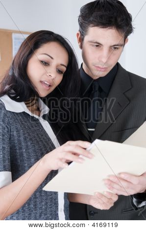 Coworkers Going Over Files