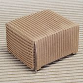 a corrugated cardboard box on a corrugated cardboard background