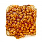 Baked beans on toast, isolated on white background.  Overhead view.