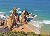 Coast of Portugal, cape Kabo-da-Roca. Picturesque, the freakish form of a rock on the bank of Atlan
