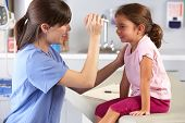 stock photo of human eye  - Doctor Examining Child - JPG