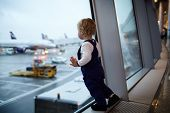 stock photo of terminator  - Kid near the window in the airport - JPG