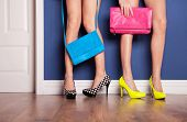 image of stiletto  - Two girls wearing high heels waiting at the door - JPG
