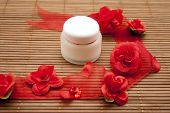 Face Creme with red flower ribbon