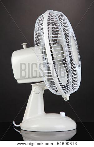 Electric fan on grey background
