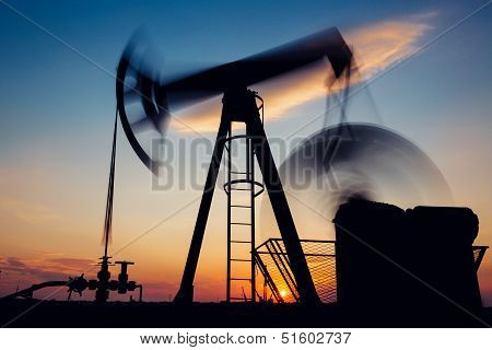 Pump jack on the sunset,long exposure
