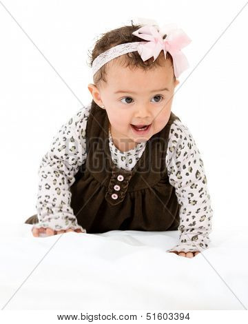Beautiful baby girl crawling - isolated over a white background