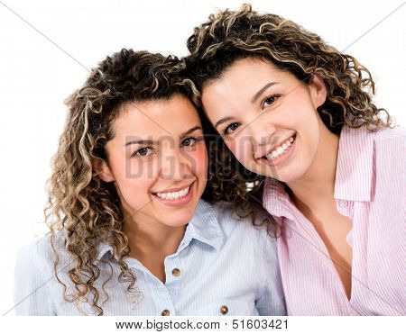 Happy female twins - isolated over a white background