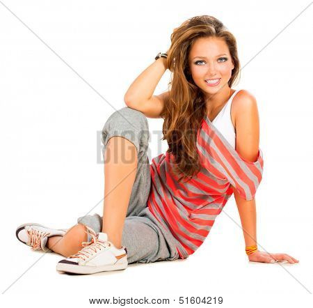 Teenage Girl sitting and Smiling. Beautiful Teen Girl Portrait. Isolated on a White Background. Teenager