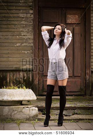 Fashion Pretty Young Woman Posing Outdoor