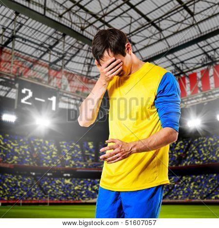 soccer or football player are celebrating goal on stadium