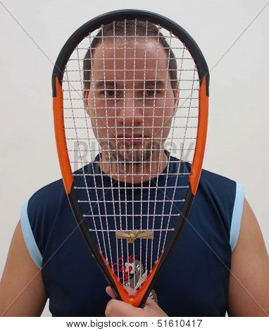Squash player with racket