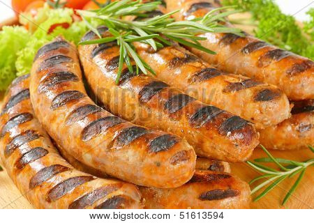 grilled sausages with burned grid