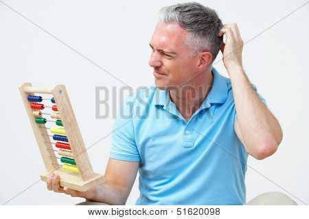 Puzzled Man Using Abacus