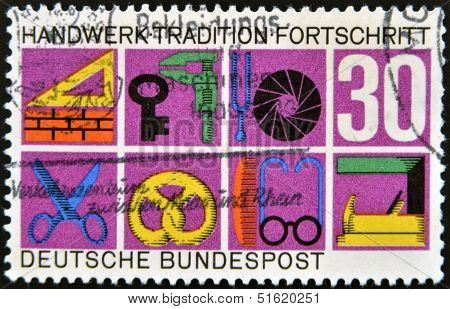 stamp printed in Germany shows German Federal Republic Crafts and Trades trade symbols
