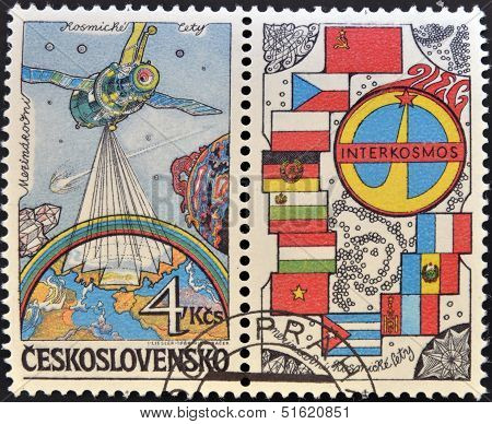 stamp dedicated to Soviet Intercosmos program shows orbital station and flag