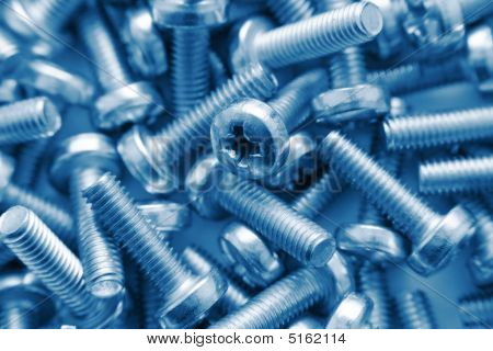 Bunch Of Screws As Background In Blue