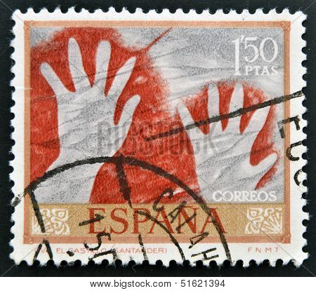 A stamp shows a cave painting of two hands in the negative the castle cave Santander