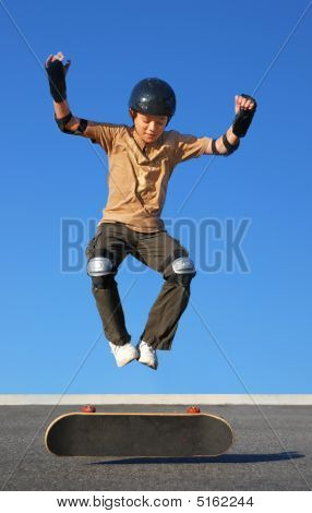 Boy Jumping High From Skateboard