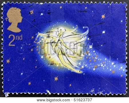 A stamp printed in Great Britain shows tinkerbell. Stamp dedicated to Peter Pan