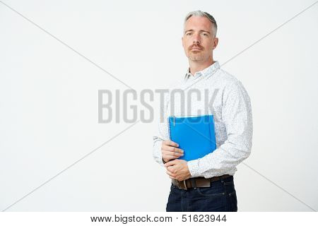Studio Portrait Of Male Pre School Teacher