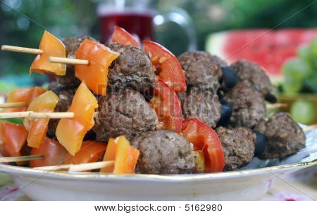 Grilled Meetballs With Vegetables On Wooden Sticks