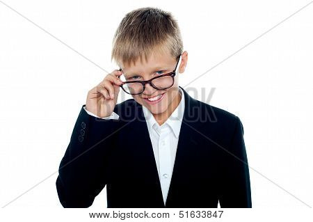 Young Business Boy Looking Through His Glasses