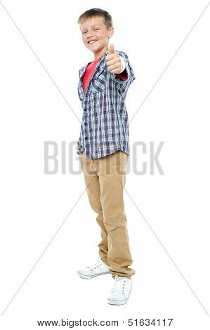 Smartly Dressed Young Kid Showing Thumbs Up Gesture
