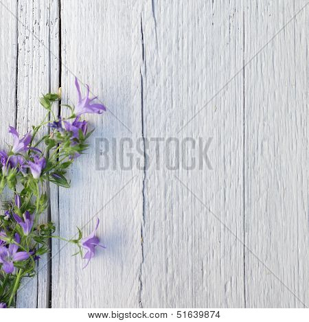 Bunch Of Purple Flowers On White Painted Wood