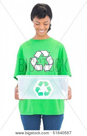 Delighted black haired ecologist holding a recycling box on white background